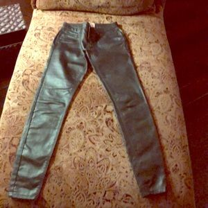 Green faux leather jeans